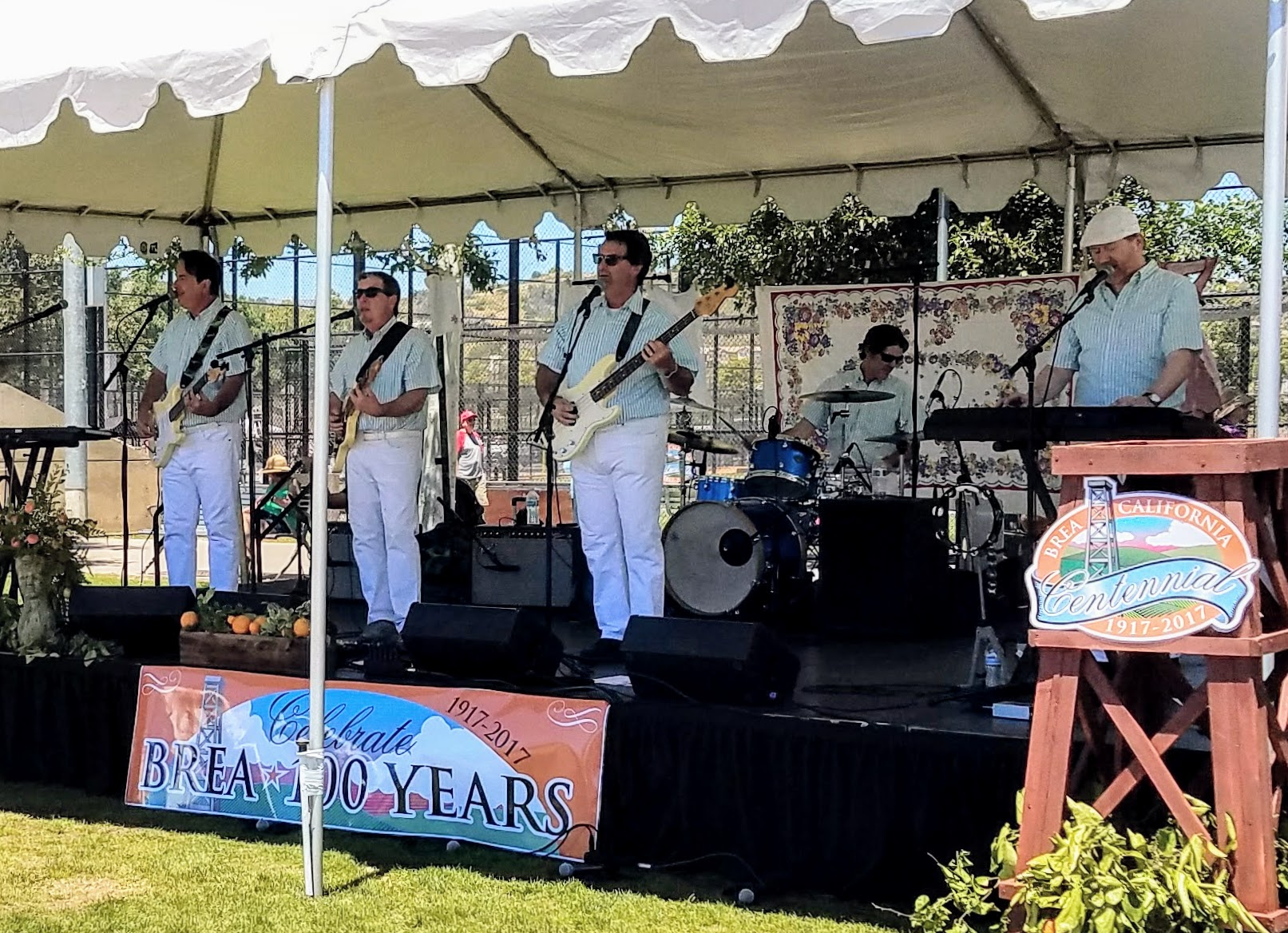We're waxin' down our surfboards, we can't wait 'til June! (Note the classic mint & white pinstripe shirts on this Beach Boys cover band.) (Photo Courtesy of Dena Sommer)