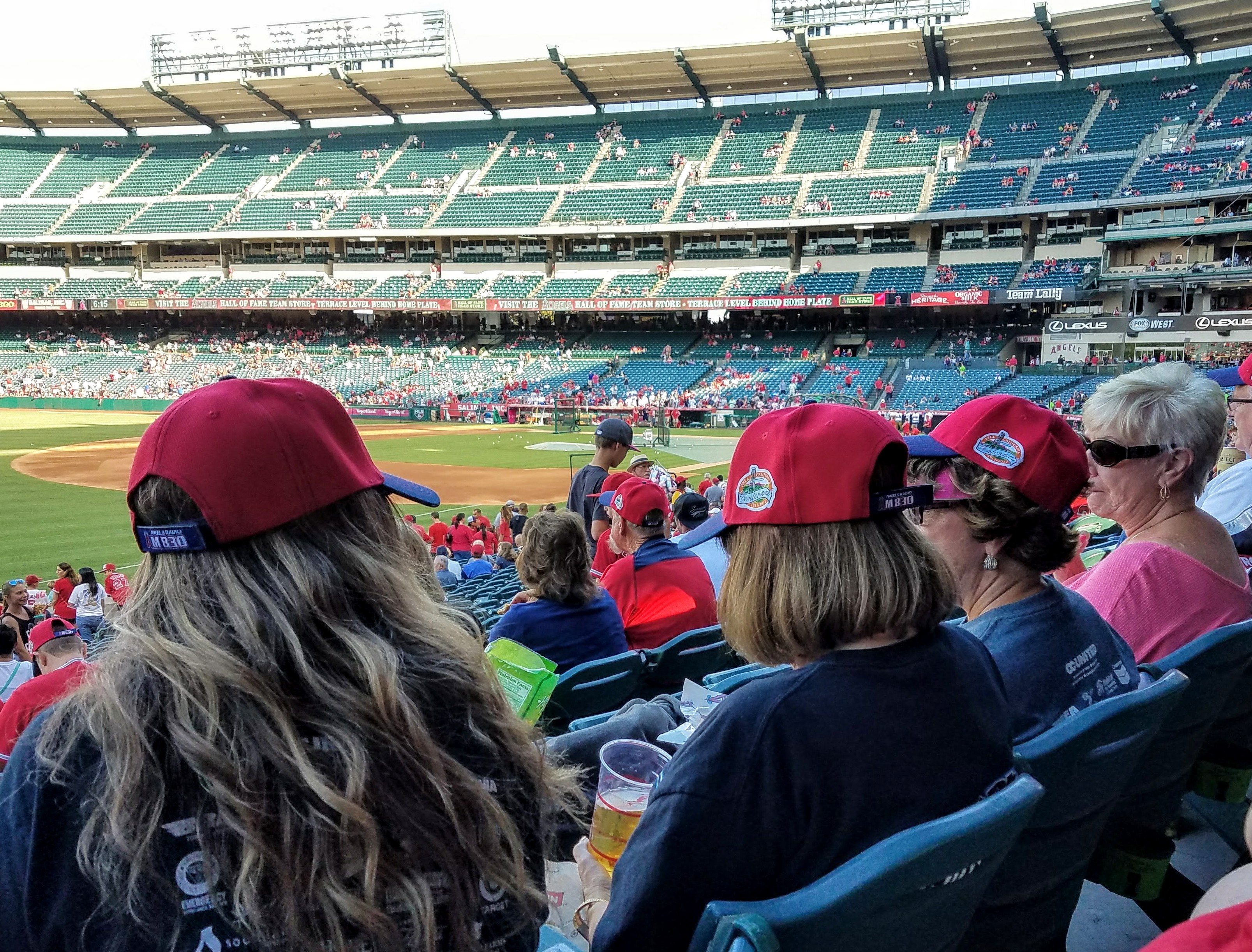 Brea ladies sportin' their new commemorative Brea Centennial Angels caps. (Photo Courtesy of Dena Sommer)