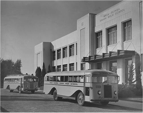 1950's era busses parked in front of Brea-Olinda High School, circa 1951. Notice that the original columns above the entrance are no longer there due to the 1933 Long Beach earthquake. (Photo Courtesy of the Brea Museum & Historical Society)