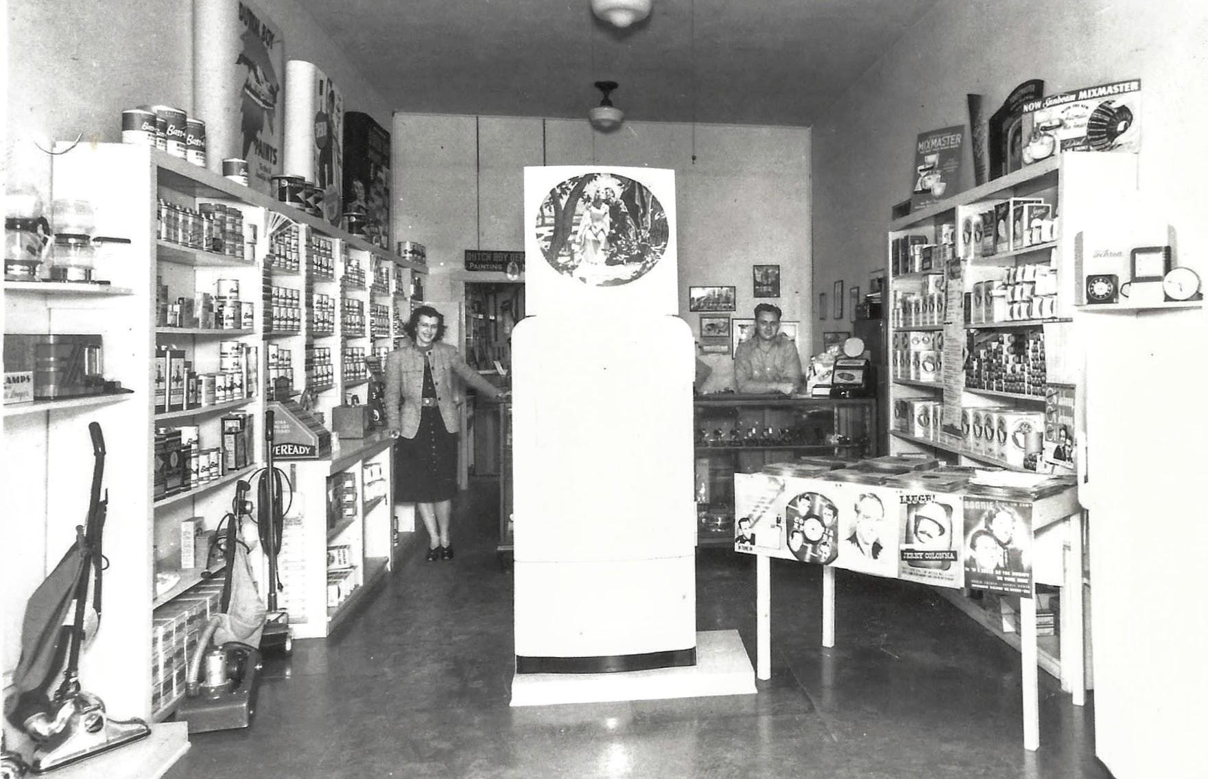 Lenore & Frank Holly in their retail store at Brea Electric. Back then, they sold refrigerators, TV's, radios, vacuum cleaners, you name it. Nowadays, they provide a wide array of electrical installations. No more appliances, however. (Photo Courtesy of Richard Holly)
