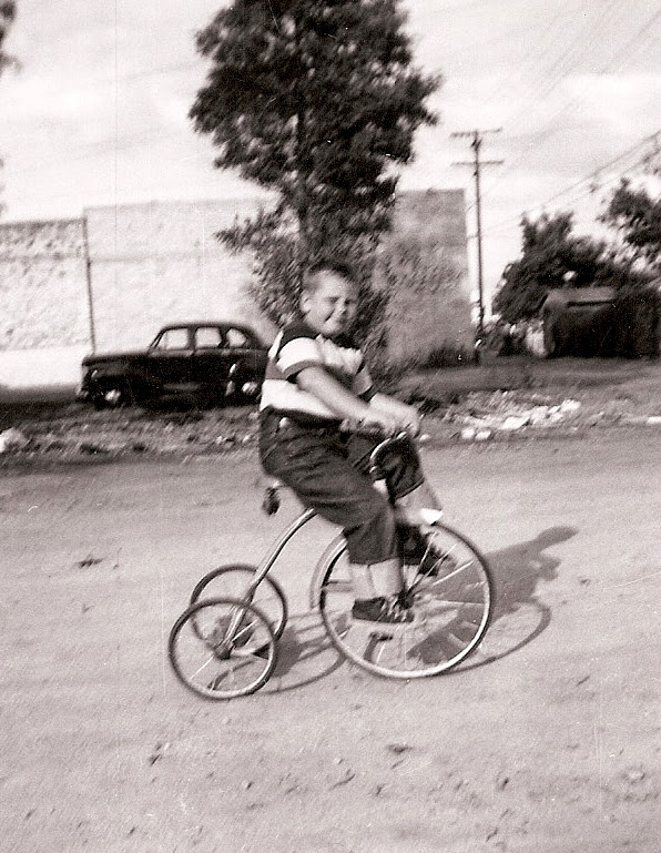Terry Sullivan, age 4, on his tricycle at 222 1/2 South Pomona Avenue (Photo Courtesy of Terry Sullivan)